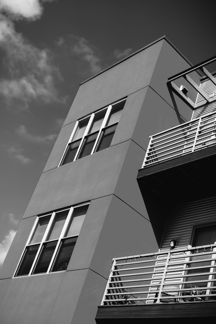 low-angle-photography-of-orange-concrete-building-under-blue-1436190